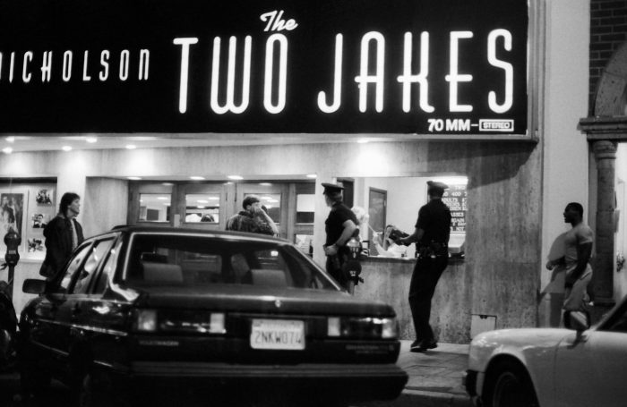 Policemen in front of a cinema entrance