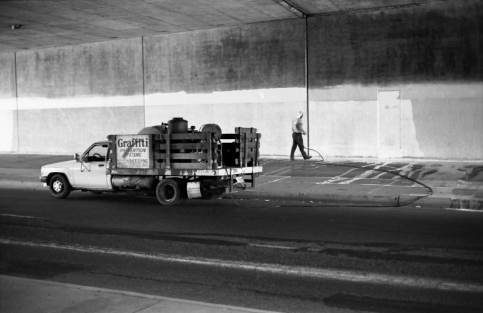 Tag Hunter working under a bridge