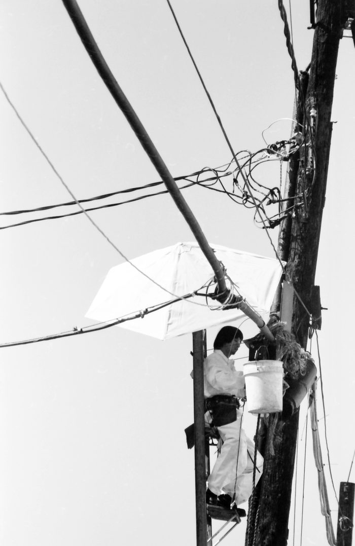 Electrician working on top of a pylon