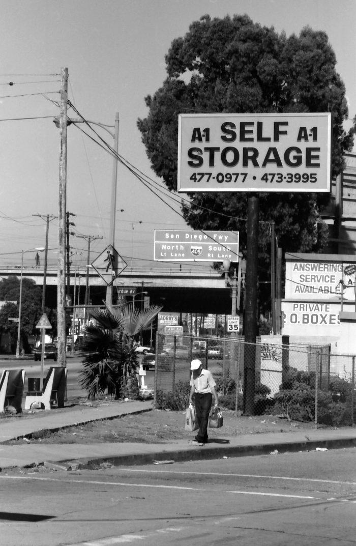 Man walking under the self storage sign