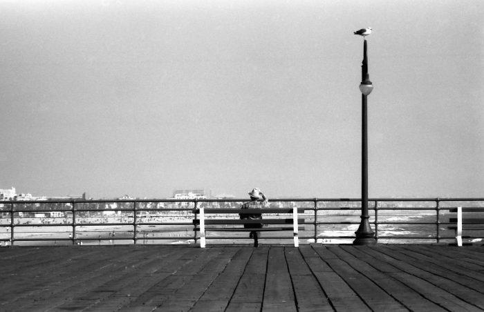 Man in hat sitting on bench